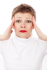 猫背による頭痛・肩こり